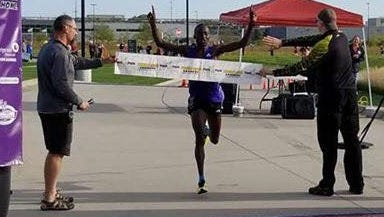 Sammy Rotich, crossing the finish line after breaking the half marathon course record at Park to Park on Saturday.