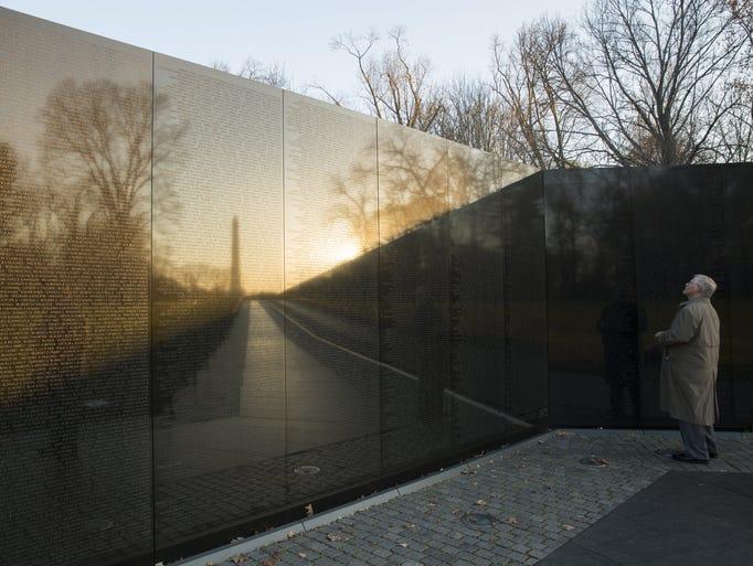Sun rises over the Vietnam Veterans Memorial in Washington,