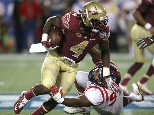 FSU's Dalvin Cook breaks away from Ole Miss' Issac Gross on a run during their game at Camping World Stadium on Monday, Sept. 5, 2016.