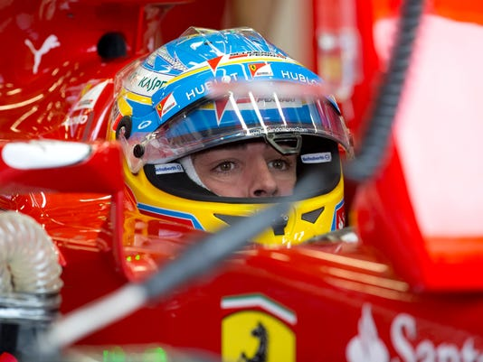 Spain's Fernando Alonso of Ferrari sits in his car during a practice session before the British Formula One Grand Prix at Silverstone circuit, Silverstone, England, Saturday, July 5, 2014. Nico Rosberg of Germany qualified in pole position with fellow countryman Sebastian Vettel second and Britain's Jenson Button third for the British Formula One Grand Prix which will be held on Sunday, July 6, 2014. (AP Photo/Jon Super)