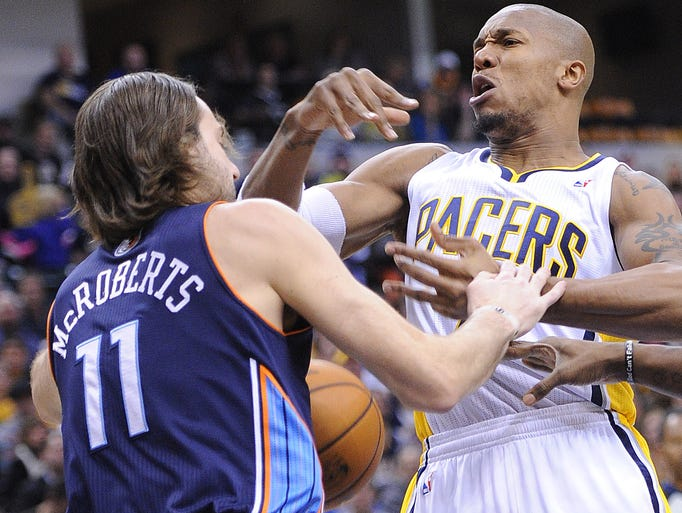 Josh McRoberts and David West battle for a rebound. The Pacers hosted the Charlotte Bobcats in NBA action Friday December 13, 2013 at Bankers Life Fieldhouse.