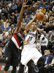 Minnesota Timberwolves' Kevin Martin, right, eyes the