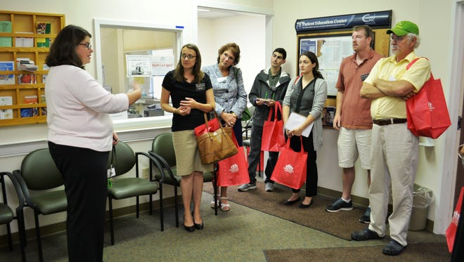 In honor of National Community Health Center Week, Safe Harbor, a homeless health care provider, hosted tours of the Burlington facility on the day of their tenth anniversary on Wednesday. Here, Clinical Social Worker Erin Ahearn starts the tour.