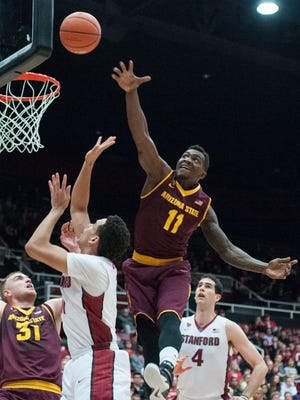 Arizona State Sun Devils forward Savon Goodman (11) attempts to block a shot against Stanford Cardinal guard/forward Dorian Pickens (11) during the first half at Maples Pavilion in Stanford, Calif., on Jan. 24.