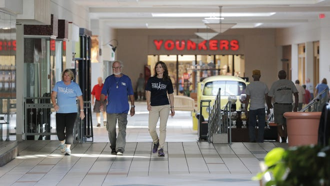 Dr. Karen Meyer, Mel Sprague and Terri St. Lawrence walk inside Forest Mall Tuesday in Fond du Lac.  Agnesian HealthCare's program Walk with a Doc kicked off earlier this year, where providers spend time one-on-one with their patients walking the interior of the mall.