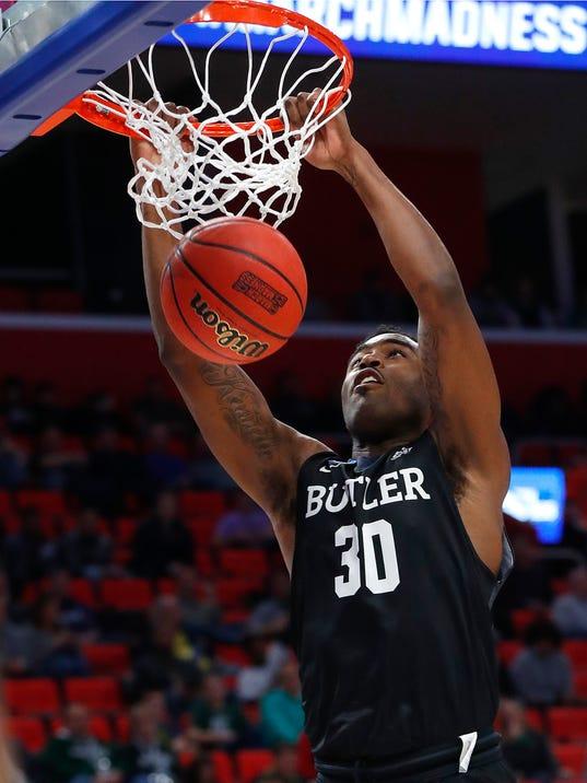 Butler forward Kelan Martin (30) dunks against Arkansas during the second half of an NCAA men's college basketball tournament first-round game in Detroit, Friday, March 16, 2018. (AP Photo/Paul Sancya)