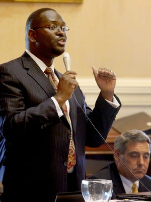 Sen. Clementa Pinckney speaks at the South Carolina Statehouse in Columbia, S.C. Pinckney was killed Wednesday in a shooting at a historic black church in Charleston, S.C., where he was pastor.
