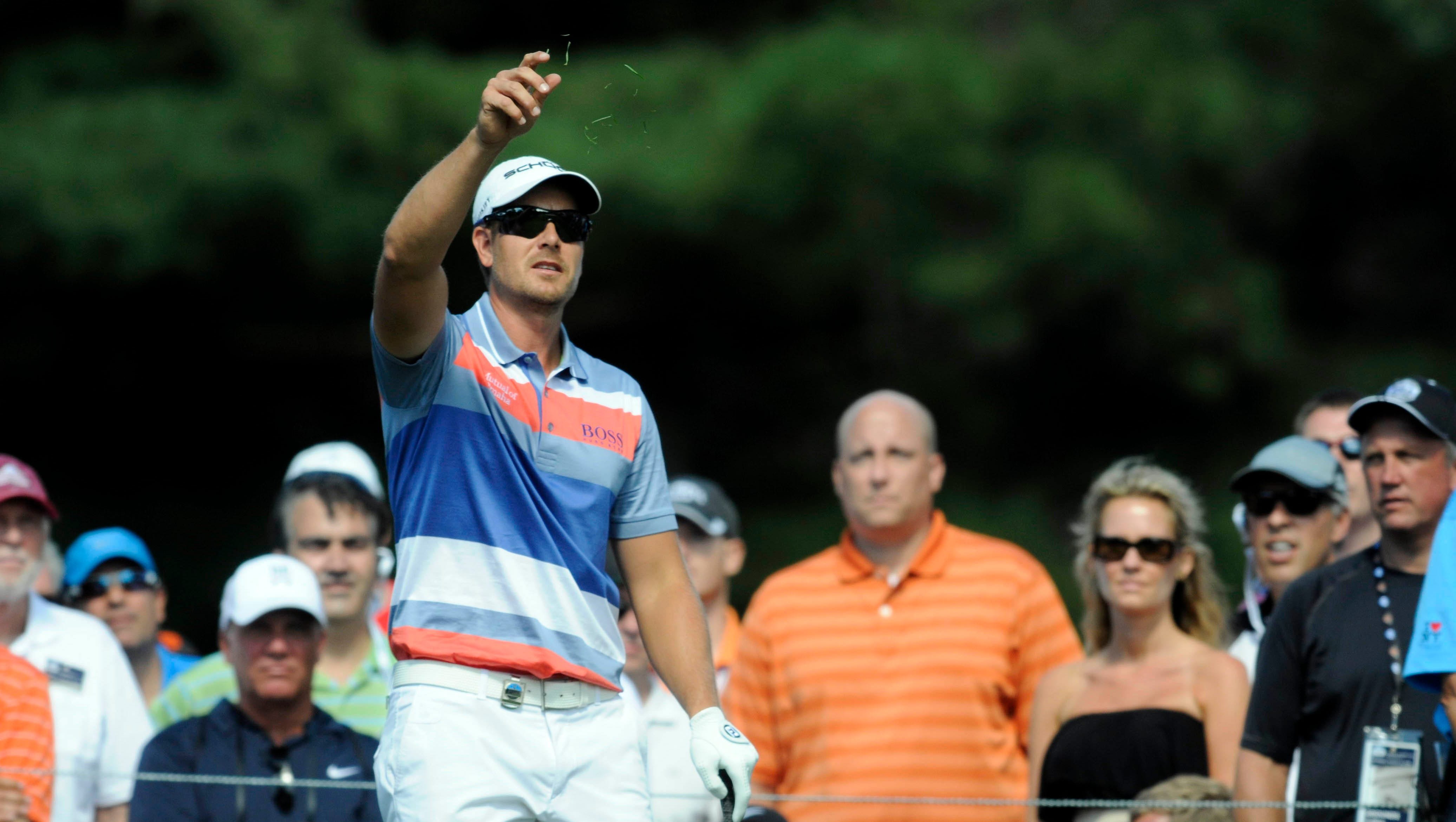 Henrik Stenson tests the wind on the sixth tee.