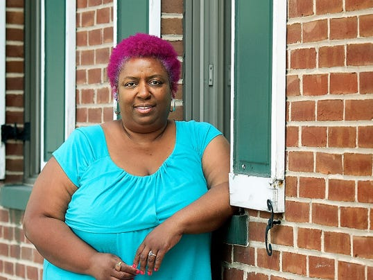 Christine Lincoln, York City's poet laureate, poses near her home. After moving from Manchester Township, she discovered the not-so-rosy side of the White Rose city and has become an advocate for tenants' rights. Hear Lincoln's thoughts on the city's housing crisis at www.yorkdispatch.com.