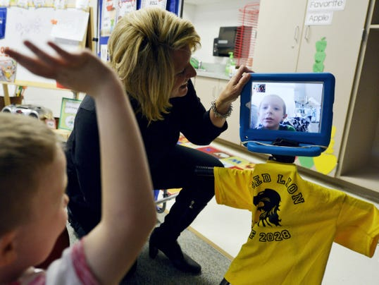 Pleasant View Elementary School kindergarten teacher Molly Heilman sets up a FaceTime session with kindergartner Landon Knepp, who participates in his class from his hospital bed. When he's receiving treatment at Penn State Hershey Children's Hospital, Landon, who was diagnosed with stage 4 neuroblastoma in October 2014, dials into his class via an iPad to interact with his classmates and teachers.