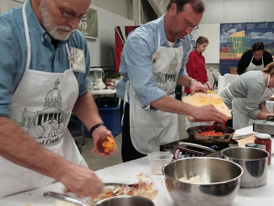 Alan Graham, Matt Wood and Tonia Emmons, left to right, cook under pressure Wednesday night at the Capital Cook-off at the Vermont Farm Show.