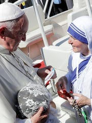 Pope Francis talks with a nun of the Sisters of the