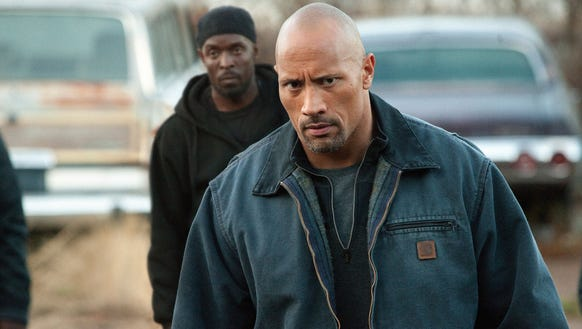 "Dwayne Johnson stars as a dad taking on a drug cartel in ""Snitch."""