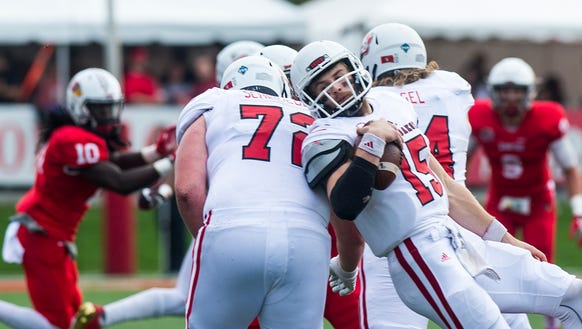 South Dakota quarterback Chris Streveler (15) gets
