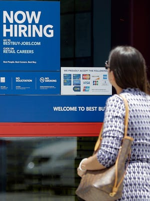 In this Monday, May 22, 2017, photo, a customer enters a Best Buy store in Hialeah, Fla. On Thursday, June 29, 2017, the Labor Department reports on the number of people who applied for unemployment benefits a week earlier.