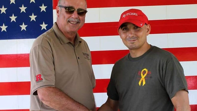 Fred Davis, director of the Rutgers University-Camden Veterans Affairs Office, with  combat veteran Joshua Piccoli of Berlin Borough in a photo taken at the Jeremy Kane Memorial Run in Cherry Hill last year. The university is raising money for a scholarship in memory of Piccoli, who died in March.