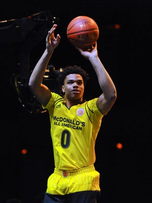 Miles Bridges competes in the boys three-point shootout contest during the McDonald's All-American Jam Fest, Monday, March 28, 2016, in Chicago.