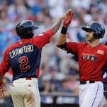United States' Joey Gallo, right, celebrates with teammate J.P. Crawford after hitting a two-run home run in the All-Star Futures Game on Sunday in Minneapolis.