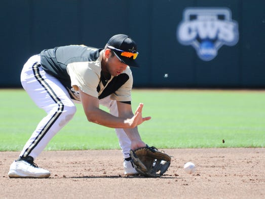 Vanderbilt's Vince Conde fields a ground ball during practice Friday at TD Ameritrade Park.