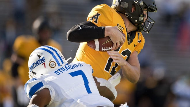 Appalachian State quarterback Zac Thomas is sacked by Georgia State's Jordan Strachan during the Mountaineers' 17-13 victory Nov. 14 at Kidd Brewer Stadium in Boone, N.C.