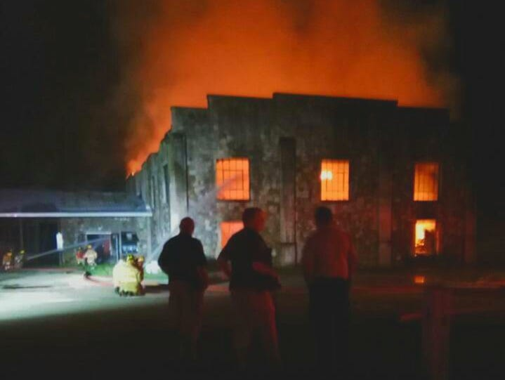 On-lookers watch as fire consumes Springville's historic gym.