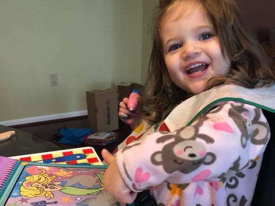 Natalie Smith, 2, and her mom Maxine spent the snow day doing crafts at home.