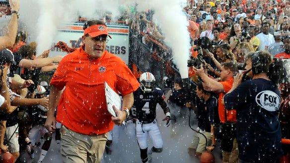 Auburn and head coach Gus Malzahn will open up the