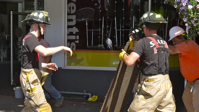 The Salem Fire Department and Northwest Natural Gas work together to restore gas to the downtown Salem following a gas leak early Tuesday morning in Venti's Cafe + Basement Bar.