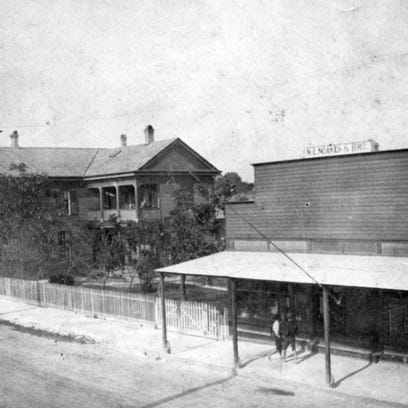 Kinney House became Noessel's with sign of an Indian chief