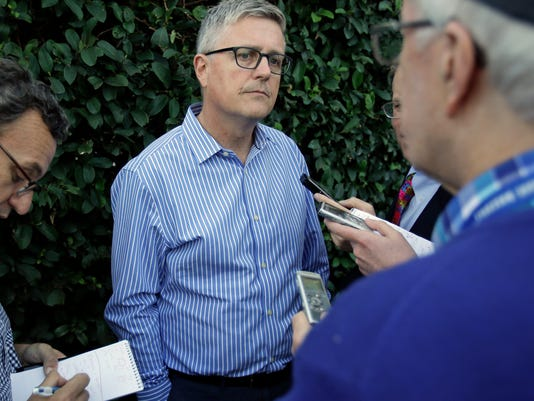 "FILE - In this Nov. 13, 2017, file photo, Jeff Luhnow, general manager for the Houston Astros, talks with reporters at the annual baseball general managers' meetings, in Orlando, Fla. The Astros believe the only way to build on their success is by putting last year behind them and looking ahead to do more in 2018. ""These guys are not satisfied with what happened and they want to... take a great team and make it legendary,"" general manager Jeff Luhnow said.(AP Photo/John Raoux, File)"