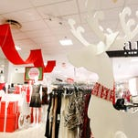 Holiday decorations welcome customers into the store Thursday, Nov. 19, 2015, at the Valley West Mall JC Penny in West Des Moines.