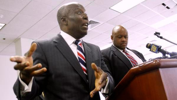 Spring Valley Mayor Demeza Delhomme with village attorney Jerrold Miles at a press conference at the Louis Kurtz Civic Center in Spring Valley on July 15, 2014.