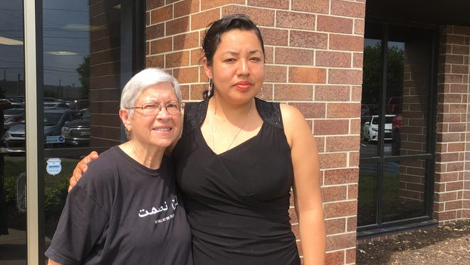 Erika Fierro (right) stands with Faith in Indiana member JoAnne Lingle in Indianapolis