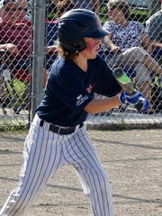 Joe Simpson executes a bunt for the Birmingham U-12 team in recent state tournament action in the Upper Peninsula.
