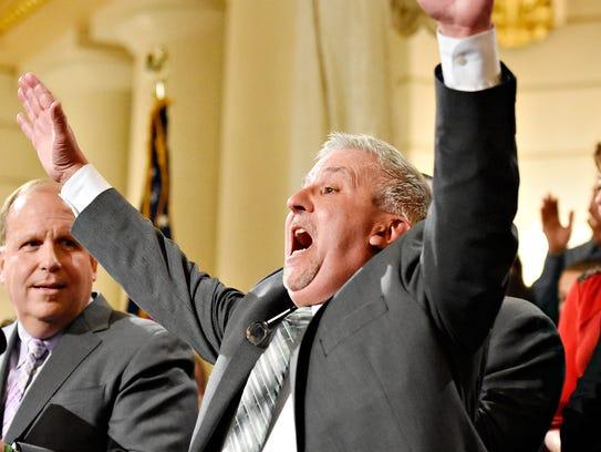 """Sen. Mike Folmer yells, """"We won,"""" as he speaks before"""