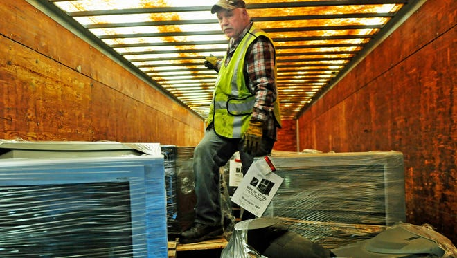 Timothy Richardson works in a trailer filled with discarded TVs Tuesday, March 24, 2015 at Washington Township Transfer Station. The township has discontinued most of the service.