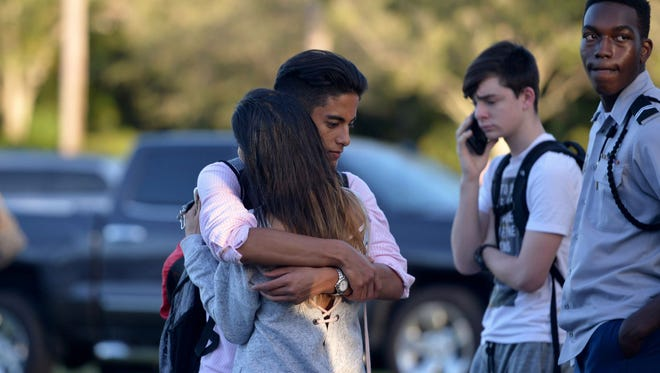 "Jorge Zapata,16, a student at Marjory Stoneman Douglas High School in Parkland, Fla., embraces his mother, Lavinia Zapata, after a mass shooting Wednesday, Feb. 14, 2018, at the school. ""I was just really incredibly, indescribably happy to see him, because you never know,"" Lavinia Zapata said."