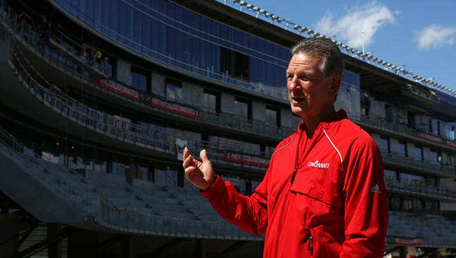 Tommy Tuberville, UC's head football coach, talks to local media in April.