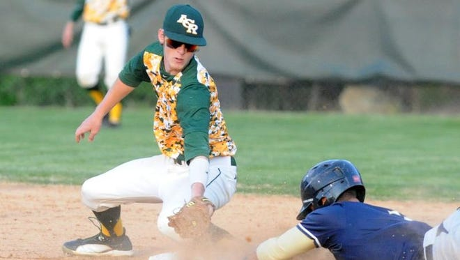 Scenes from Friday's Reynolds-Roberson baseball game.