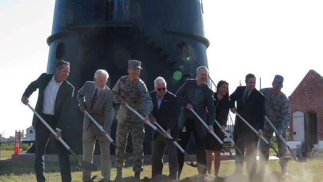 Officials participate in a groundbreaking ceremony on March 22 for the first of three replicas of the original lighthouse keepers' cottages at the Cape Canaveral Lighthouse.