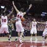 Gary Harris (center) and Michigan State nearly knocked off the Badgers in Madison last season, losing 60-58. Wisconsin, struggling before the Spartans' visit, took off from that point forward on a run that lasted all the way to the Final Four. The Badgers appear on track for a similar postseason run this season.
