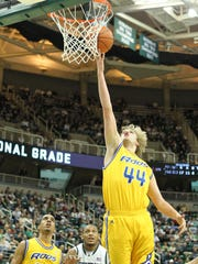 UMKC Kangaroos forward/center Kirk Korver (44) lays up the ball during the first half at Jack Breslin Students Events Center. Michigan State won 89-54.