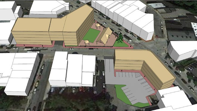 One of six preliminary plans suggested for the Market Square sites in Ossining village by the Downtown Revitalization Group. The plans show a general scheme for the building, not finished designs.