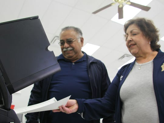 Tony (left) and Grace Rodriguez cast their ballots in the 2017 school board election Tuesday morning.