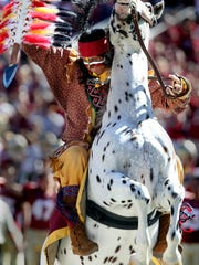 Osceola fires a spear into the turf to start the game on Saturday. FSU used a swarming defense and the arm and legs of quarterback E.J. Manuel to win 41-16  against the Maryland Terrapins on a gorgeous Fall day at Doak Campbell Stadium.
