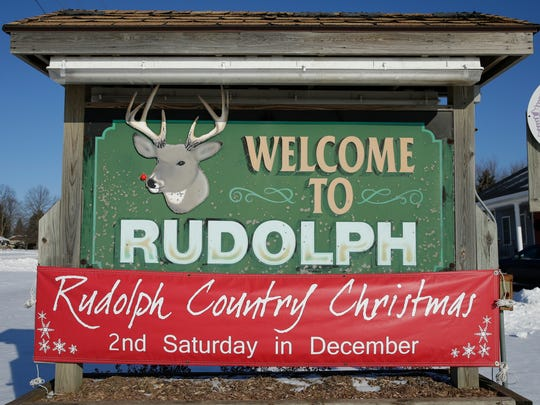 A sign welcome visitors to Rudolph, a village in Wood