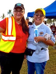 Guam Sunshine Lions Club member, Lion Dee Cruz, right,
