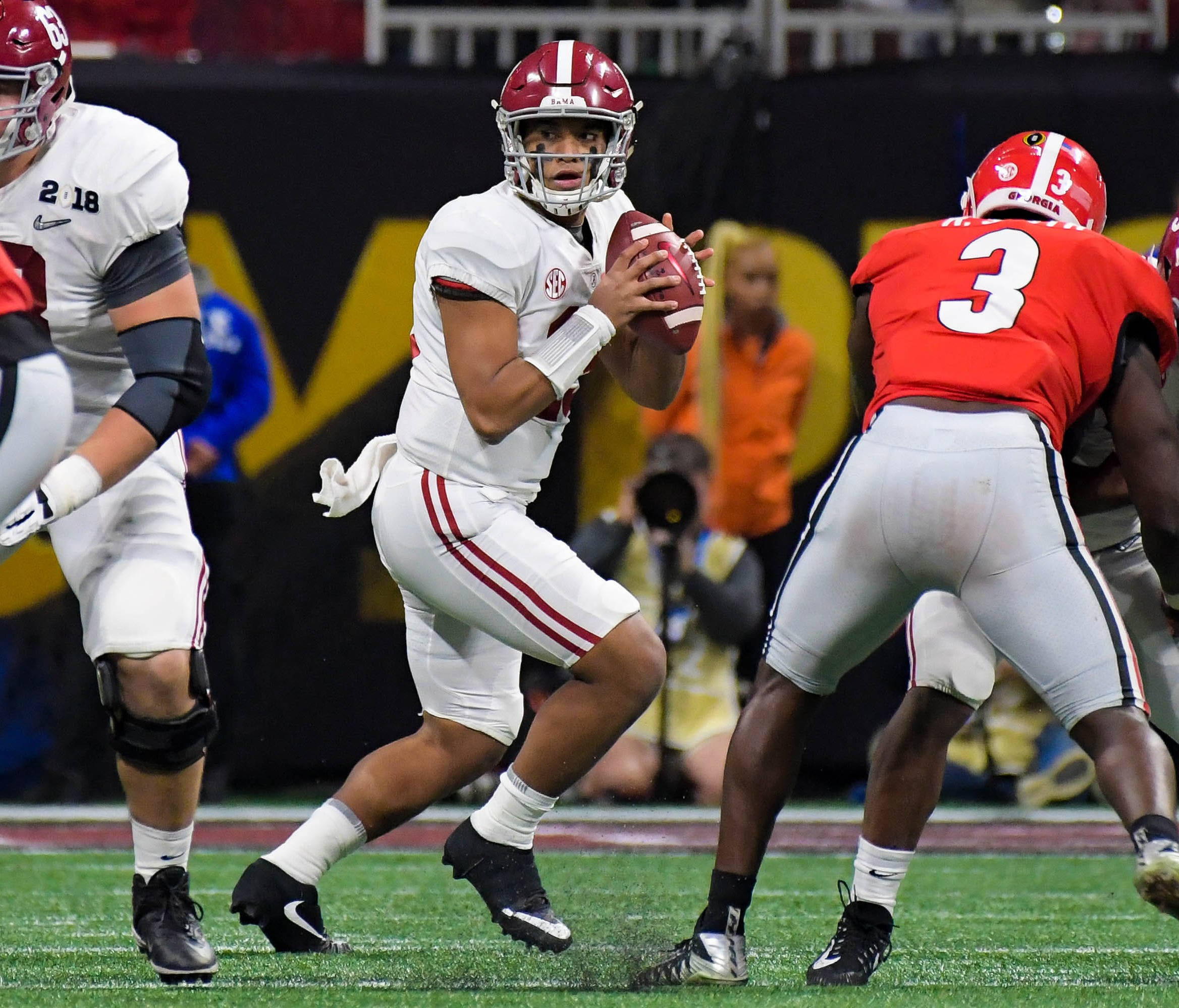 Alabama quarterback Tua Tagovailoa looks to pass against Georgia during the third quarter of the College Football Playoff championship game.