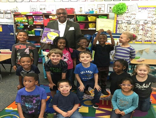 100 BMOTA President Eric Friall poses with Sealey kindergarteners