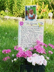 A photo of Isabel Rose Godfrey, 3, is part of a display